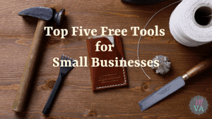 Tools on a wooden table with the Top Five Free Tools for Small Businesses and May Virtual Assists logo