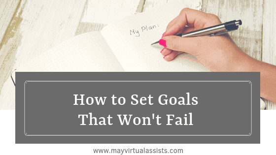 A woman's hand writing My Plan in a white notebook with How to Set Goals that Won't Fail and mayvirtualassists.com